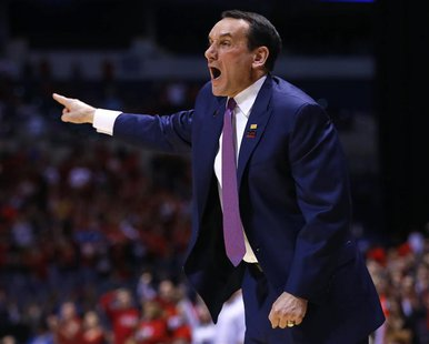 Duke Blue Devils head coach Mike Krzyzewski yells instructions to his team in the first half during their Midwest Regional NCAA men's basket