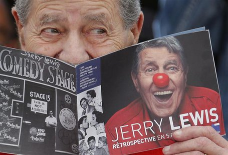 "Cast member Jerry Lewis poses during a photocall for the film ""Max Rose"" at the 66th Cannes Film Festival in Cannes May 23, 2013. REUTERS/Re"