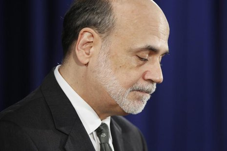Federal Reserve Chairman Ben Bernanke pauses during remarks about a significant shift in the direction of U.S. monetary policy at the Federa