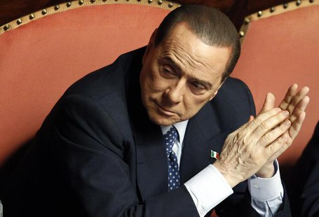 People of Freedom (PDL) party member and former Prime Minister Silvio Berlusconi attends the Upper house of the parliament in Rome, April 30