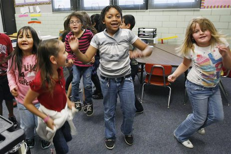 Students at Rose Hill Elementary School jump around doing a counting exercise that is also aerobic exercise in their classroom in Commerce C