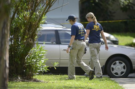 FBI personnel walk through the complex surrounding the apartment, where Ibragim Todashev was shot and killed by FBI, in Orlando, Florida, Ma