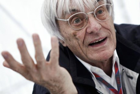 Formula One commercial supremo Bernie Ecclestone gestures as he is interviewed prior to the German F1 Grand Prix at the Nuerburgring circuit