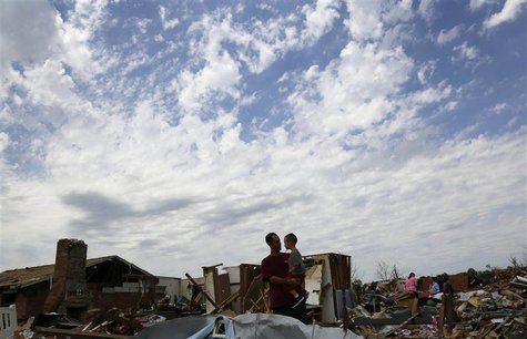 Justin Stephan (L) shows his son Timothy, 3, his tornado-destroyed home for the first time since the storm on 6th Avenue in Moore, Oklahoma