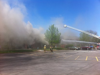 Fire at an apartment complex at 3415 Hilltop Way in Allouez on May 23, 2013. (photo by Reporter Terry Lee).