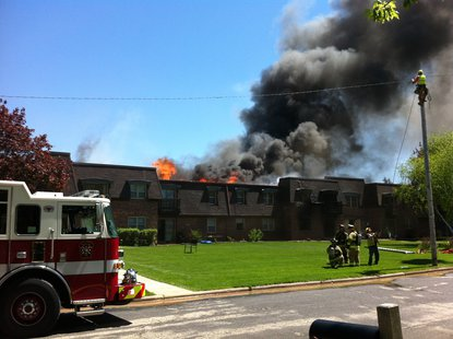 Firefighters battle an apartment complex fire at 3415 Hilltop Way in Allouez on May 23. 2013. (Photo taken by Reporter Terry Lee).