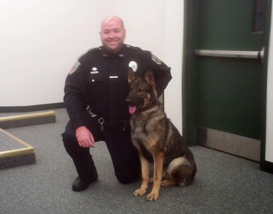 Everest Metro Officer Matt Krembs and k9 officer 'Aron' at a press conference, May 23, 2013