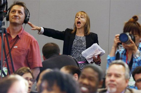 Protester Medea Benjamin, co-founder of the Code Pink activist group, interrupts U.S. President Barack Obama as he speaks about his administ