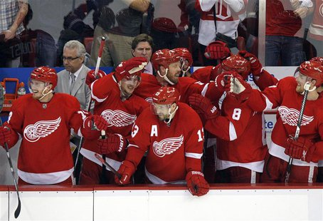 The Detroit Red Wings bench celebrate an empty net goal by Daniel Cleary against the Chicago Blackhawks in the final minute of Game 4 of the