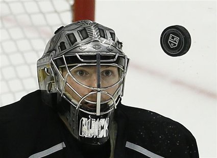Los Angeles Kings goalie Jonathan Quick keeps his eyes on the puck as he makes a save against the San Jose Sharks in the 2nd period during G