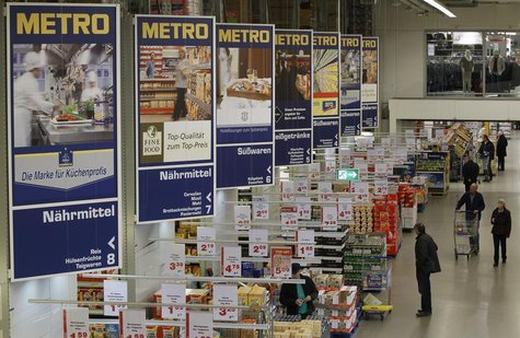 People shop at a cash and carry market of Germany's biggest retailer Metro AG in the western German city of Sankt Augustin near Bonn March 1