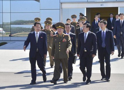 Choe Ryong-hae (C), director of the General Political Bureau of the Korean People's Army (KPA) of North Korea, walks with Chinese Ambassador