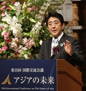 "Japan's Prime Minister Shinzo Abe delivers a speech at a dinner during the 19th International Conference on ""The Future of Asia"" in Tokyo Ma"