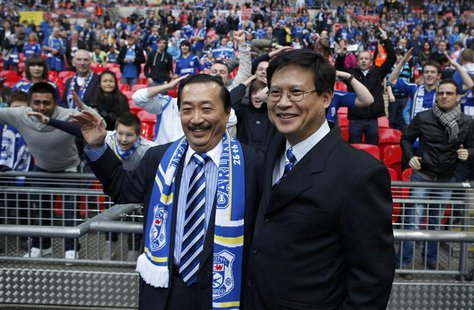Cardiff City's Malaysian Chairman Chan Tien Ghee (R) and Malaysian owner Vincent Tan smile ahead of their English League Cup final soccer ma