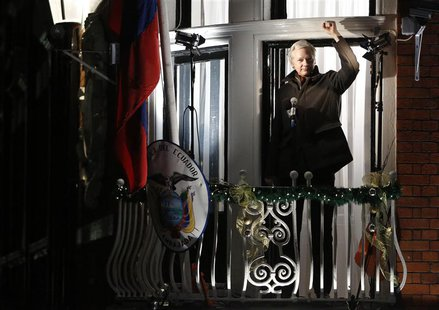 WikiLeaks founder Julian Assange gestures from the balcony of Ecuador's Embassy as he makes a speech, in central London December 20, 2012. R