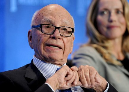 Chairman and CEO of News Corporation Rupert Murdoch talks next to Laurene Powell Jobs (R), founder of Emerson Collective and widow of the la