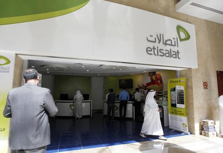A customer walks out of an Etisalat shop at the Dubai World Trade Centre in Dubai October 14, 2012. REUTERS/Jumana ElHeloueh
