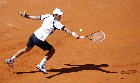 Novak Djokovic of Serbia hits a return to Tomas Berdych of Czech Republic during their men's singles quarter final match at the Rome Masters