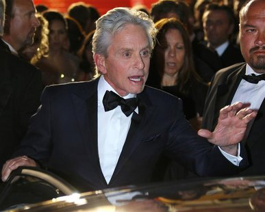 "Cast members Michael Douglas leaves after the screening of the film ""Behind the Candelabra"" in competition during the 66th Cannes Film Festi"