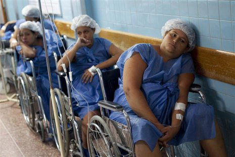 Pregnant women wait for their turn to undergo a Cesarean section (c-section) procedure at the Santa Ana public maternity hospital in Caracas
