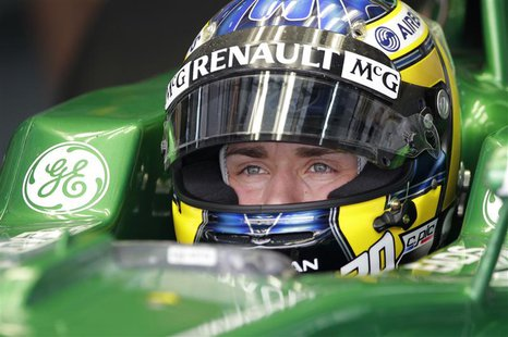 Caterham Formula One driver Charles Pic of France sits in his car during the first practice session of the Bahrain F1 Grand Prix at the Sakh