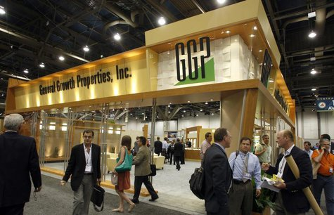 Attendees pass by the General Growth Properties booth during the International Council of Shopping Centers convention in Las Vegas, May 18,