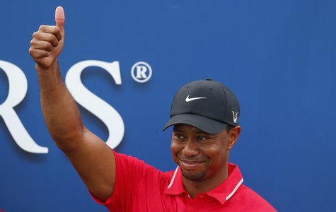 Tiger Woods reacts after being presented with The Players Championship trophy after winning the PGA golf tournament at TPC Sawgrass in Ponte