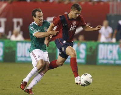 U.S. midfielder Robbie Rogers (16) is pulled down by Mexico defender Gerardo Torrado during the second half of their friendly soccer match i