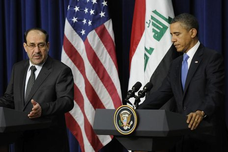 Iraq's Prime Minister Nuri al-Maliki (L) and U.S. President Barack Obama (R) hold a joint news conference in the Eisenhower Executive Office