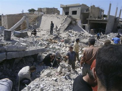 Civilians search for survivors under rubble after what activists said was shelling by forces loyal to Syria's President Bashar al-Assad, in