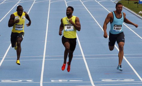 Tyson Gay of the U.S. (C) leads compatriot Ryan Bailey (R) and Nickel Ashmeade of Jamaica across the finish line winning the men's 100 meter