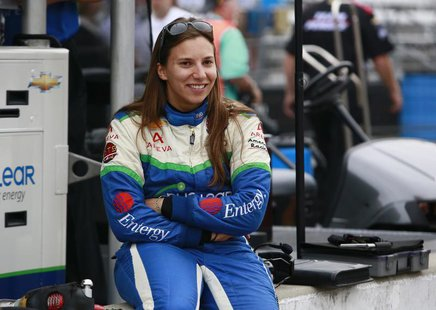 KV Racing Technology driver Simona de Silvestro of Switzerland sits on the pit lane wall smiling during a practice session prior to qualific