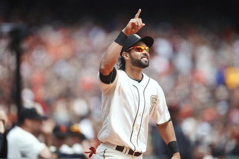 San Francisco Giants center fielder Angel Pagan gestures as he is introduced during the World Series Championship ring ceremony in San Franc