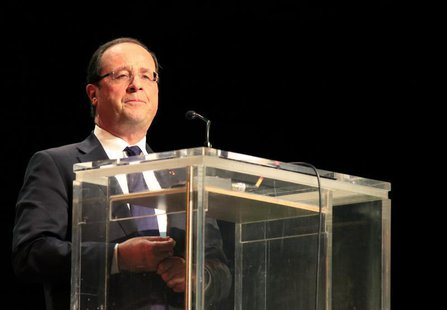 France's President Francois Hollande delivers his speech during the 50th anniversary of the establishment of the Organization of African Uni