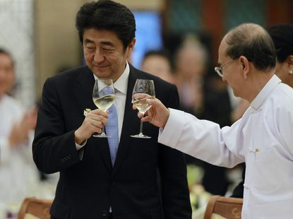 Japan's Prime Minister Shinzo Abe (L) and Myanmar's President Thein Sein toast during lunch at the Myanmar International Convention Centre i
