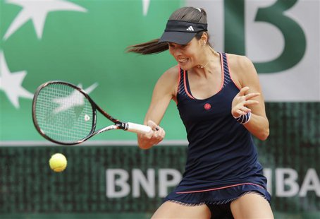 Ana Ivanovic of Serbia hits a return to Petra Martic of Croatia during their women's singles match at the French Open tennis tournament at t