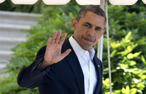 U.S. President Barack Obama waves as he walks to Marine One to depart for a day trip from the South Lawn of the White House in Washington Ma