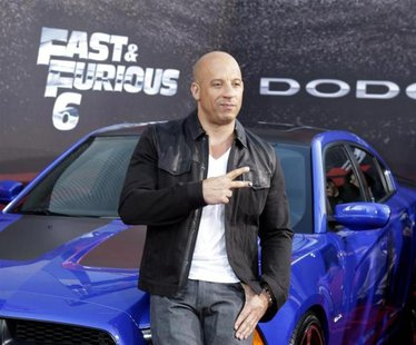 "Cast member and producer Vin Diesel poses at the premiere of the new film, ""Fast & Furious 6"" at Universal Citywalk in Los Angeles May 21, 2"
