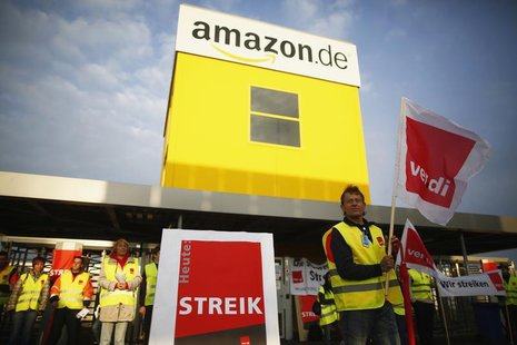 Employees of Amazon take part in a strike by German united services union Ver.di in front of an Amazon warehouse in Bad Hersfeld May 14, 201