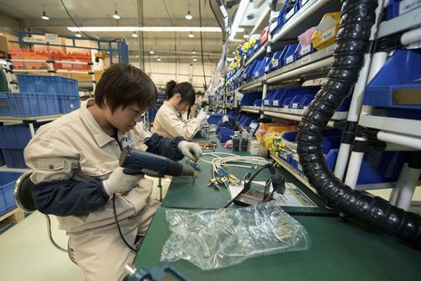 A worker assembles components at a workshop of Bernard Controls in Beijing April 25, 2013. REUTERS/Ed Jones/Pool