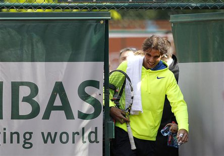 Rafael Nadal of Spain arrives for a training session at the French Open tennis tournament at the Roland Garros stadium in Paris May 25, 2013