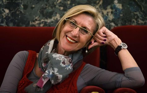 Rosa Diez, leader of the centrist Union for Democracy and Progress, or UPyD, smiles while posing for a photograph in Parliament in Madrid Ma