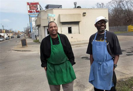 Kevin Ward (R) and Charlie Monagan, co-owners of Slabbee's Ribs & Soul, stand in front of their recently opened take-out rib joint in one of