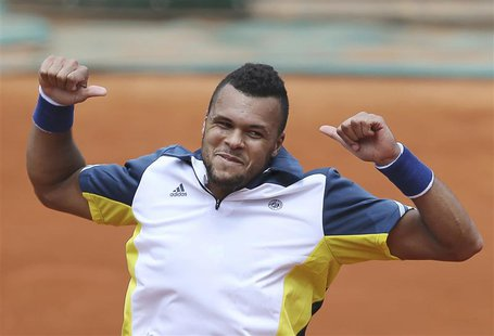 Jo-Wilfried Tsonga of France celebrates defeating Aljaz Bedene of Slovenia in their men's singles match during the French Open tennis tourna
