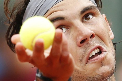 Rafael Nadal of Spain prepares to serve to Daniel Brands of Germany during their men's singles match at the French Open tennis tournament at