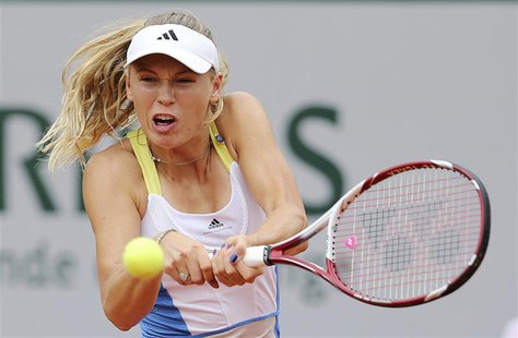 Caroline Wozniacki of Denmark hits a return to Laura Robson of Britain during their women's singles match at the French Open tennis tourname