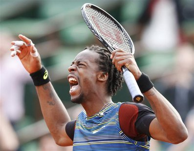 Gael Monfils of France reacts during his men's singles match against Tomas Berdych of Czech Republic at the French Open tennis tournament at