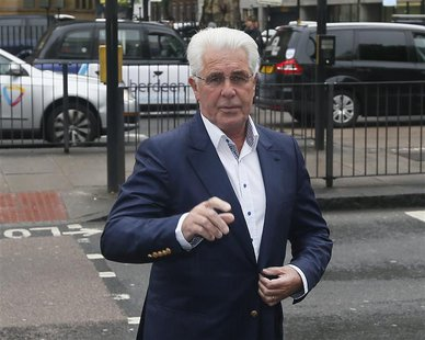 Publicist Max Clifford arrives at Westminster Magistrates Court in London May 28, 2013. Clifford faced charges of indecent assault, which he