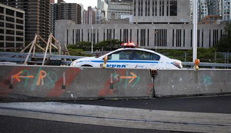 A police car stops at the entrance to the Brooklyn Bridge on Memorial Day in New York May 27, 2013.  REUTERS/Carlo Allegri