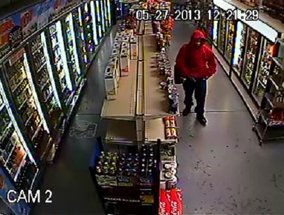 The suspect was last seen wearing a red hooded sweatshirt and black jeans as seen in surveillance footage.